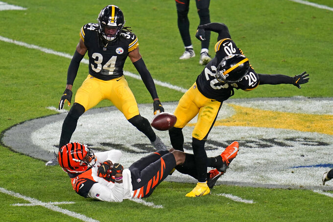 Cincinnati Bengals wide receiver Tee Higgins (85) fumbles the ball after taking a hit from Pittsburgh Steelers cornerback Cameron Sutton (20) during the first half of an NFL football game, Sunday, Nov. 15, 2020, in Pittsburgh. The ball was recovered by Steelers cornerback Steven Nelson (not shown). (AP Photo/Keith Srakocic)