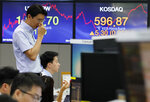 A currency trader watches monitors at the foreign exchange dealing room of the KEB Hana Bank headquarters in Seoul, South Korea, Monday, Aug. 19, 2019. Asian shares were higher Monday, as investors continue to rejigger their read on President Donald Trump's trade war and growing worries about slowing economies around the world. (AP Photo/Ahn Young-joon)