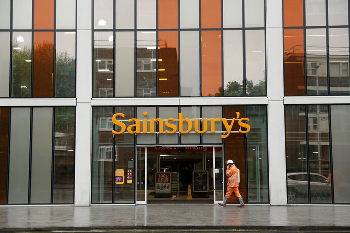 FILE- This April 30, 2018, file photo shows an exterior view of the Sainsbury's flagship store in the Nine Elms area of London. British competition regulators have blocked J. Sainsbury Plc's 7.3 billion-pound ($9.4 billion) purchase of Walmart's Asda unit, which would have created the U.K.'s biggest supermarket chain. The Competition and Markets Authority says the deal would have increased prices and reduced the quality and range of products available to shoppers, it was reported on Thursday, April 25, 2019. (AP Photo/Matt Dunham, File)
