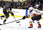 Vegas Golden Knights defenseman Zach Whitecloud (2) shoots as Anaheim Ducks' Hampus Lindholm (47) defends during the second period of an NHL hockey game Thursday, Jan. 14, 2021, in Las Vegas. (AP Photo/Isaac Brekken)
