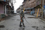 An Indian paramilitary soldier stands guard by a closed road, as Kashmiris marked Eid during lockdown to curb the spread of coronavirus in in Srinagar, Indian controlled Kashmir, Saturday, Aug. 1, 2020. Eid al-Adha, or the Feast of the Sacrifice, is marked by sacrificing animals to commemorate the prophet Ibrahim's faith in being willing to sacrifice his son. (AP Photo/Mukhtar Khan)