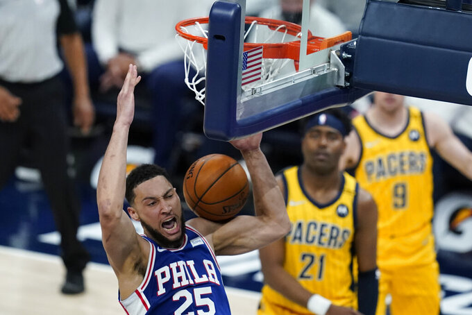 Philadelphia 76ers' Ben Simmons (25) dunks during the first half of an NBA basketball game against the Indiana Pacers, Tuesday, May 11, 2021, in Indianapolis. (AP Photo/Darron Cummings)