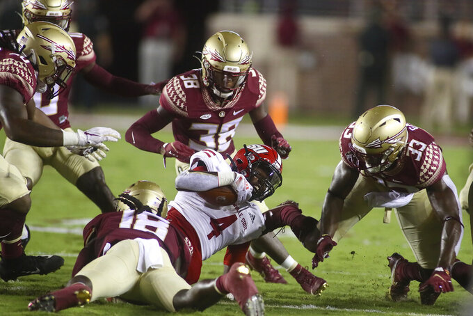 Jacksonville State wide receiver Jayson Jones (4) fights for a first down as Florida State defenders gang up on him in the first quarter of an NCAA college football game Saturday, Sept. 11, 2021, in Tallahassee, Fla. (AP Photo/Phil Sears)