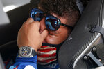 Driver Bubba Wallace, right, is overcome with emotion as he sits in his car prior to the start of the NASCAR Cup Series auto race at the Talladega Superspeedway in Talladega Ala., Monday June 22, 2020. A noose was found in the garage stall of Wallace's car yesterday. (AP Photo/John Bazemore)