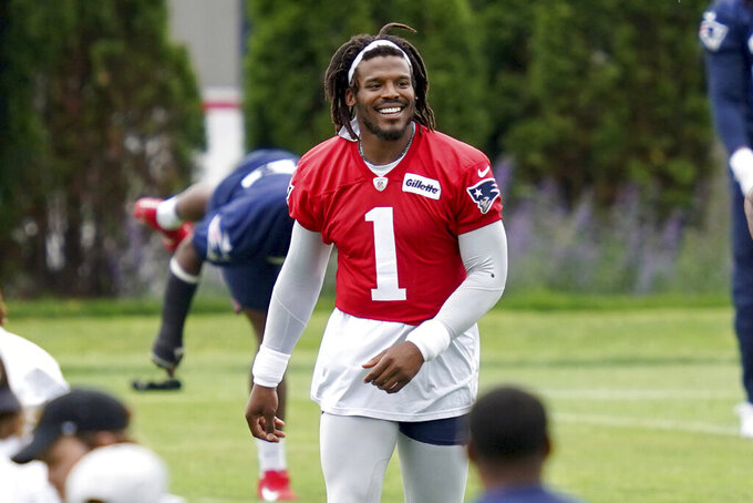 FILE - New England Patriots quarterback Cam Newton (1) smiles during NFL football practice in Foxborough, Mass., in this Friday, June 4, 2021, file photo. Cam Newton will enter Patriots training camp as New England's starting quarterback. Coach Bill Belichick made that clear multiple times this offseason. But the coach says, that like all positions, who has the job at the end of camp is an open question as the Patriots prepare to open their second camp since Tom Brady's departure.  (AP Photo/Mary Schwalm, File)