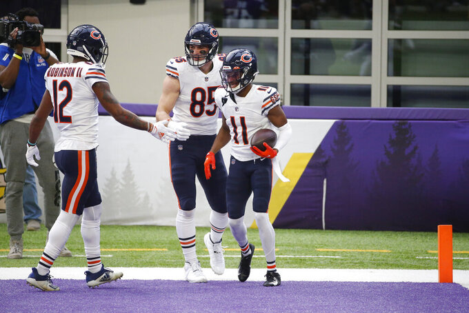 Chicago Bears wide receiver Darnell Mooney (11) celebrates with teammates after catching an 8-yard touchdown pass during the first half of an NFL football game against the Minnesota Vikings, Sunday, Dec. 20, 2020, in Minneapolis. (AP Photo/Bruce Kluckhohn)