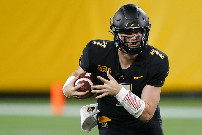Appalachian State quarterback Chase Brice carries against East Carolina during the first half of an NCAA college football game Thursday, Sept. 2, 2021, in Charlotte, N.C. (AP Photo/Chris Carlson)
