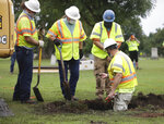 Researchers work on a test excavation at Oaklawn Cemetery in a search for a possible mass burial site from the 1921 Tulsa Race Massacre Monday, July 13, 2020 in Tulsa. (Mike Simons/Tulsa World via AP)