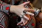 Victoria De Angelis, bass player of of Italian band Maneskin, winners of the Eurovision Song Contest in May, touches the rings on her hand during an interview with the Associated Press at a hotel in Rome, Tuesday, July 27, 2021. (AP Photo/Riccardo De Luca)
