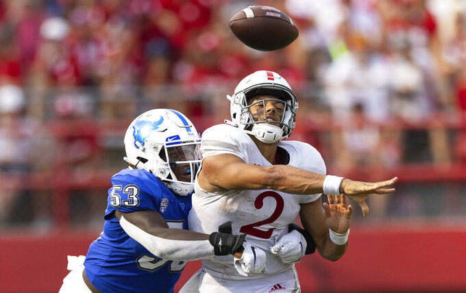 Buffalo's C.J. Bazile (53) tackles Nebraska quarterback Adrian Martinez (2) as he attempts to make a pass during the second half of an NCAA college football game, Saturday, Sept. 11, 2021, at Memorial Stadium in Lincoln, Neb. (AP Photo/Rebecca S. Gratz)