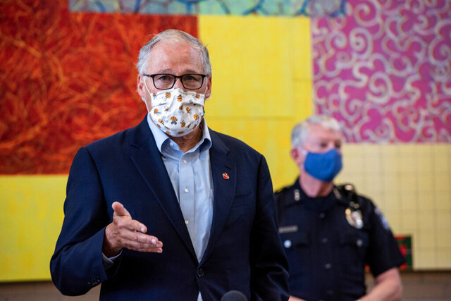 Washington Gov. Jay Inslee speaks at the Columbia Basin College campus in the Tri-Cities on Tuesday June 30, 2020 about the spread of the coronavirus in Benton and Franklin counties. (Jennifer King/The Tri-City Herald via AP)