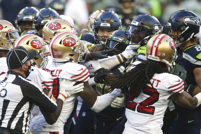 Seattle Seahawks and San Francisco 49ers players scuffle after a personal foul penalty was called on a late hit to quarterback Russell Wilson during the second half of an NFL football game, Sunday, Nov. 1, 2020, in Seattle. The Seahawks won 37-27. (AP Photo/Scott Eklund)
