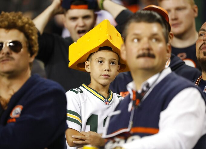 A fan watches during the first half of an NFL football game between the Green Bay Packers and the Chicago Bears Thursday, Sept. 5, 2019, in Chicago. (AP Photo/Charles Rex Arbogast)