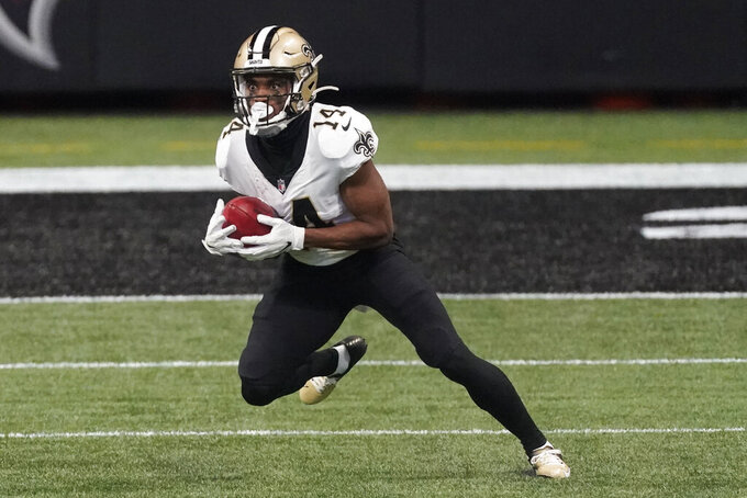 New Orleans Saints wide receiver Tommylee Lewis (14) runs against the Atlanta Falcons during the first half of an NFL football game, Sunday, Dec. 6, 2020, in Atlanta. (AP Photo/John Bazemore)