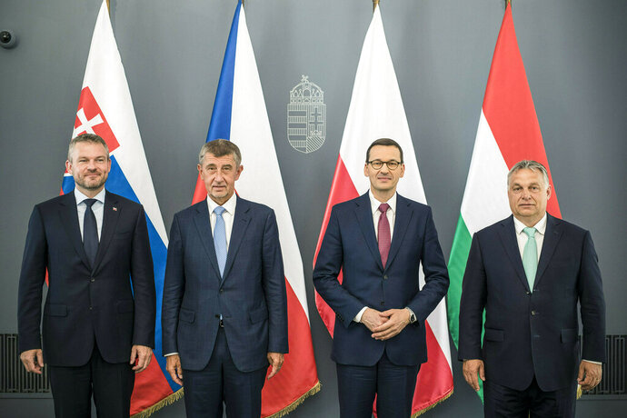 Slovakian Prime Minister Peter Pellegrini, from left, Czech Prime Minister Andrej Babis, Polish Prime Minister Mateusz Morawiecki and Hungarian Prime Minister Viktor Orban pose for a family photo during their informal meeting of the heads of the V4 (Visegrad Group) countries in the premier's office in Budapest, Hungary, Thursday, June 13, 2019. (MTI/Hungarian Prime Minister's Press Office via AP)