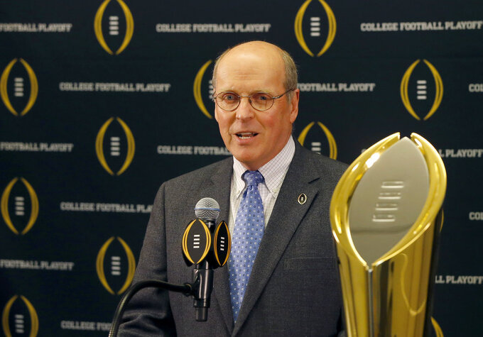 FILE - This is a Nov. 4, 2015, file photo showing College Football Playoff executive director Bill Hancock speaking during a press conference, in Rosemont, Ill. When talking about possible College Football Playoff expansion, the word momentum gets tossed around a lot as those who cover and follow the sport search for insight from experts and hints about what is next from power brokers. The postseason system is not quite halfway through a 12-year contract with ESPN that runs through 2026. The fifth College Football Playoff national champion will be crowned Monday night when No. 1 Alabama faces No. 2 Clemson at Levi's Stadium in Santa Clara, California. Expansion seems inevitable. (AP Photo/Charles Rex Arbogast, File)