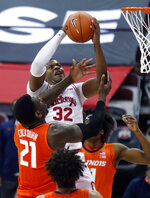Ohio State forward E.J. Liddell, top, goes up to shoot against Illinois center Kofi Cockburn during the first half of an NCAA college basketball game in Columbus, Ohio, Saturday, March 6, 2021. (AP Photo/Paul Vernon)