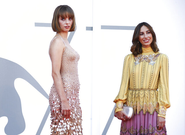 Actress Maya Hawke, left, and director Gia Coppola pose for photographers upon arrival at the premiere for the film 'Mainstream' during the 77th edition of the Venice Film Festival in Venice, Italy, Saturday, Sept. 5, 2020. (Photo by Joel C Ryan/Invision/AP)