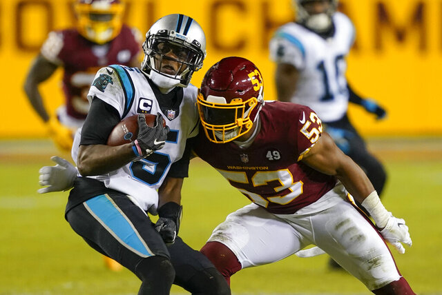 Carolina Panthers quarterback Teddy Bridgewater (5) runs into Washington Football Team inside linebacker Jon Bostic (53) during the second half of an NFL football game, Sunday, Dec. 27, 2020, in Landover, Md. (AP Photo/Susan Walsh)