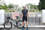 Australian Murray Higgs stands outside the Kranji War Memorial cemetery in his exercise outfit during ANZAC Day, in Singapore Saturday, April 25, 2020. Higgs has lived in Singapore for 20 years and has been attending the annual ANZAC Day dawn service at the cemetery, but this year's commemorative events have been cancelled due to COVID-19 circuit breaker measures being enforced at the city state. (AP Photo/YK Chan)