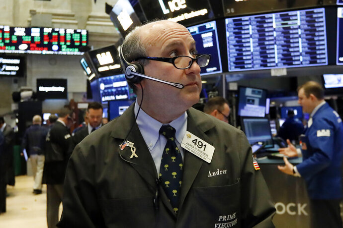 FILE- In this Feb. 5, 2019, file photo trader Andrew Silverman works on the floor of the New York Stock Exchange. The U.S. stock market opens at 9:30 a.m. EST on Friday, Feb. 15. (AP Photo/Richard Drew, File)