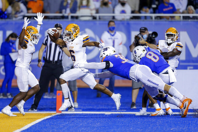 UTEP wide receiver Jacob Cowing (6) breaks through the tackle attempt by Boise State defensive end Demitri Washington (38) on a 38-yard touchdown reception during the first half of an NCAA college football game Friday, Sept. 10, 2021, in Boise, Idaho. (AP Photo/Steve Conner)