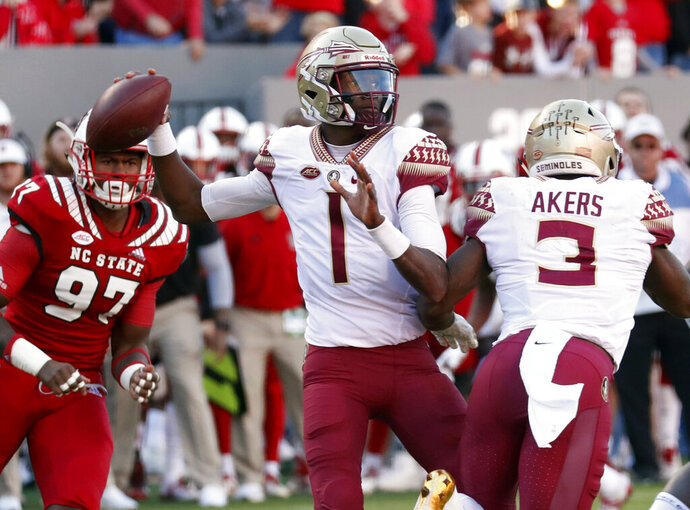 FILE - In this Nov. 3, 2018, file photo. Florida State's James Blackman (1) looks to pass during the first half of the team's NCAA college football game against North Carolina State in Raleigh, N.C. Florida State coach Willie Taggart's top _ and perhaps only _ option at quarterback is redshirt sophomore James Blackman, the full-time starter in 2017 when Francois missed virtually the entire season with a ruptured patellar tendon(AP Photo/Chris Seward, File)