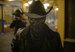 """This image released by Universal Pictures shows a scene from """"The Forever Purge,"""" directed by Everardo Valerio Gout. (Universal Pictures via AP)"""