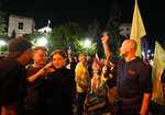 People protests outside the Polish parliament after lawmakers passed a bill seen as harmful to media freedom in Warsaw, Poland, Wednesday, Aug. 11, 2021. Poland's parliament voted Wednesday in favor of a bill that would force Discovery Inc., the U.S. owner of Poland's largest private television network, to sell its Polish holdings and is widely viewed as an attack on media independence in Poland. (AP Photo/Czarek Sokolowski)