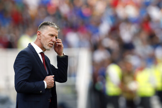 In the file picture taken on Saturday, Sept. 7, 2019, Czech Republic coach Jaroslav Silhavy gestures during the Euro 2020 group A qualifying soccer match between Kosovo and Czech Republic, at Fadil Vokrri stadium in Pristina, Kosovo. A staff member of the Czech national soccer team was tested positive for COVID-19 ahead of the start of the UEFA Nations League campaign. The Czech team said on Wednesday Sept. 2, 2020, that all the other members of the team, including the players and coaches, tested negative in additional testing. (AP Photo/Visar Kryeziu/File)