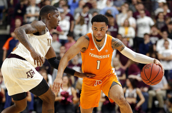 Tennessee guard Lamonte Turner (1) drives around Texas A&M guard Jay Jay Chandler, left, during the second half of an NCAA college basketball game Saturday, Feb. 2, 2019, in College Station, Texas. (AP Photo/Michael Wyke)