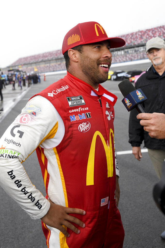 Bubba Wallace is interviewed after winning a NASCAR Cup series auto race Monday, Oct. 4, 2021, in Talladega, Ala. (AP Photo/John Amis)