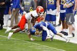 Sam Houston State wide receiver Ife Adeyi, left, catches a pass as he is defended by South Dakota State safety Chase Norblade, right, during the second half of the NCAA college FCS Football Championship in Frisco, Texas, Sunday, May 16, 2021. (AP Photo/Michael Ainsworth)