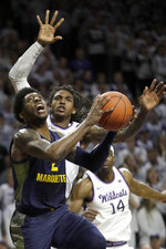 Marquette guard Sacar Anim (2) shoots after getting past Kansas State guard Cartier Diarra, back left, during the first half of an NCAA college basketball game in Manhattan, Kan., Saturday, Dec. 7, 2019. (AP Photo/Orlin Wagner)