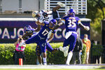 Navy wide receiver Mark Walker (80) tries to hurdle over East Carolina defensive back Warren Saba (17) during an NCAA football game on Saturday, Oct. 17, 2020, in Greenville, N.C. (AP Photo/Jacob Kupferman)