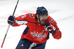 Washington Capitals left wing Alex Ovechkin (8) celebrates his first goal of an NHL hockey game during the third period against the New York Rangers, Friday, March 19, 2021, in Washington. (AP Photo/Nick Wass)