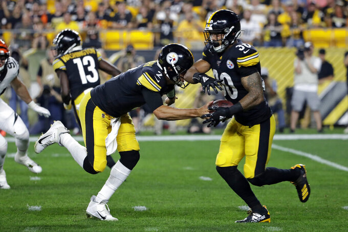 Pittsburgh Steelers quarterback Mason Rudolph (2) hands off to running back James Conner (30) first half of an NFL football game against the Cincinnati Bengals in Pittsburgh, Monday, Sept. 30, 2019. (AP Photo/Don Wright)