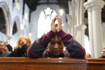 In this Sunday, Dec. 15, 2019, photo, Diely Martinez, 30, prays inside the Holyrood Episcopal Church-Iglesia Santa Cruz in New York. Martinez started volunteering as a sermon interpreter after her mother, who is deaf, began attending the church last year. (AP Photo/Emily Leshner)