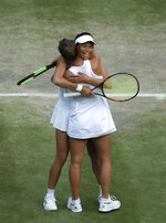 Czech Republic's Barbora Strycova and Taiwan's Su-Wei Hsieh celebrate defeating Canada's Gabriela Dabrowski and China's Yifan Xu in the women's doubles final match of the Wimbledon Tennis Championships in London, Sunday, July 14, 2019. (AP Photo/Ben Curtis)
