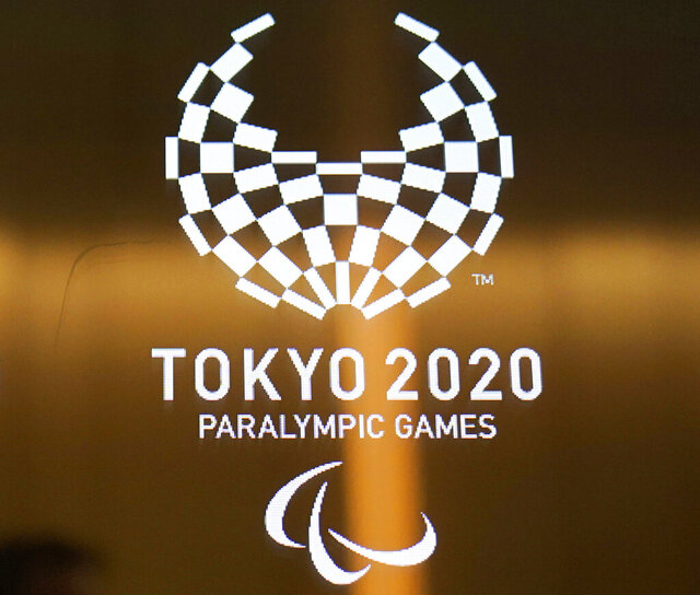 FILE - In this June 11, 2019, file photo, the logo of the Tokyo 2020 Paralympics on display in Tokyo.  Wheelchair basketball was removed from the 2024 Paralympic program on Friday Jan. 31, 2020, and could be cut from the upcoming Tokyo Games as well, as the International Paralympic Committee and the International Wheelchair Basketball Federation are in a dispute about how players are graded. (AP Photo/Jae C. Hong, File)