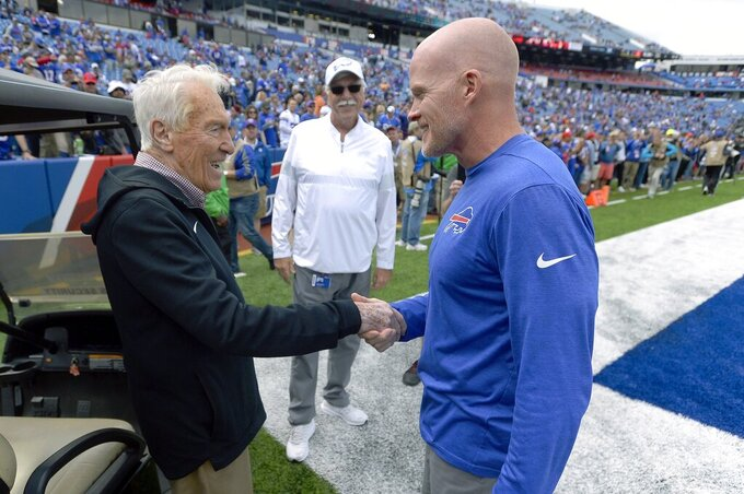 Former Buffalo Bills head coach Marv Levy, left, speaks to current head coach Sean McDermott, right, before an NFL football game between the Bills and the New England Patriots, Sunday, Sept. 29, 2019, in Orchard Park, N.Y. (AP Photo/Adrian Kraus)
