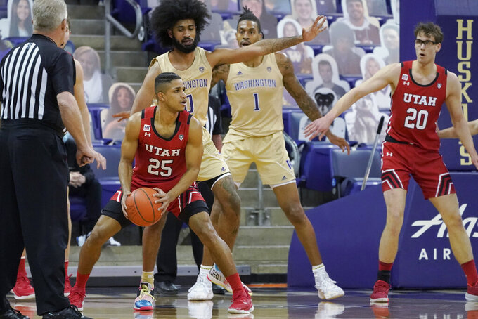 Utah guard Alfonso Plummer (25) looks to pass as Washington guard Marcus Tsohonis (0) defends during the first half of an NCAA college basketball game, Sunday, Jan. 24, 2021, in Seattle. (AP Photo/Ted S. Warren)