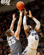 Villanova forward Saddiq Bey (41) shoots over Xavier forward Jason Carter (25) during the first half of an NCAA college basketball game, Monday, Dec. 30, 2019, in Villanova, Pa. (AP Photo/Laurence Kesterson)