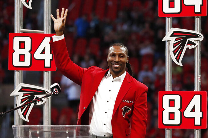 Former Atlanta Falcons player Roddy White speaks during a Falcons Ring of Honor ceremony during half time of an NFL football game between the Atlanta Falcons and the Carolina Panthers, Sunday, Dec. 8, 2019, in Atlanta. (AP Photo/John Bazemore)