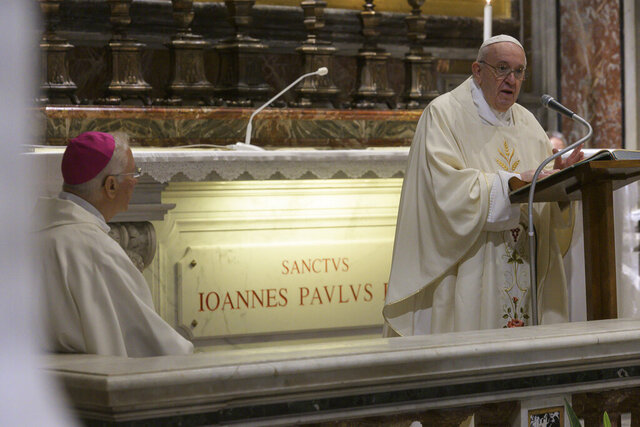 Pope Francis celebrates a Mass for the 100th anniversary of the birth of Pope John Paul II, in St. Peter's Basilica, at the Vatican Monday, May 18, 2020. The Pope held the morning mass in the chapel where is located the grave of John Paul II. (Vatican Media via AP)