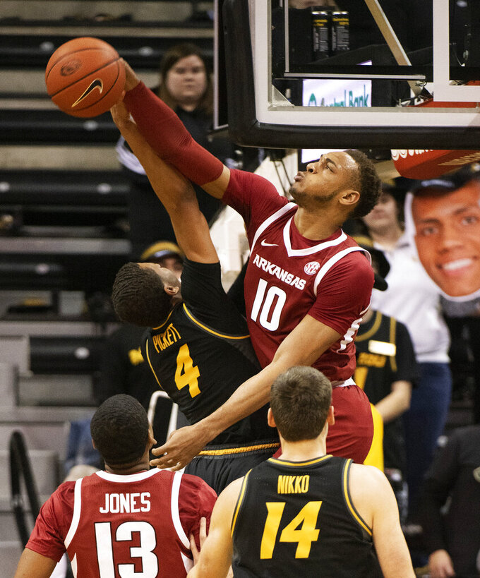 Arkansas's Daniel Gafford, right, blocks the shot of Missouri's Javon Pickett, left, during the first half of an NCAA college basketball game Tuesday, Feb. 12, 2019, in Columbia, Mo. (AP Photo/L.G. Patterson)