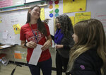 Chabot Elementary School principal Jessica Cannon, center, talks with fourth grade teacher Laura Shield during class in Oakland, Calif., Monday, March 4, 2019. Thousands of Oakland teachers are back in classrooms after union members voted to approve a contract deal. (AP Photo/Jeff Chiu)