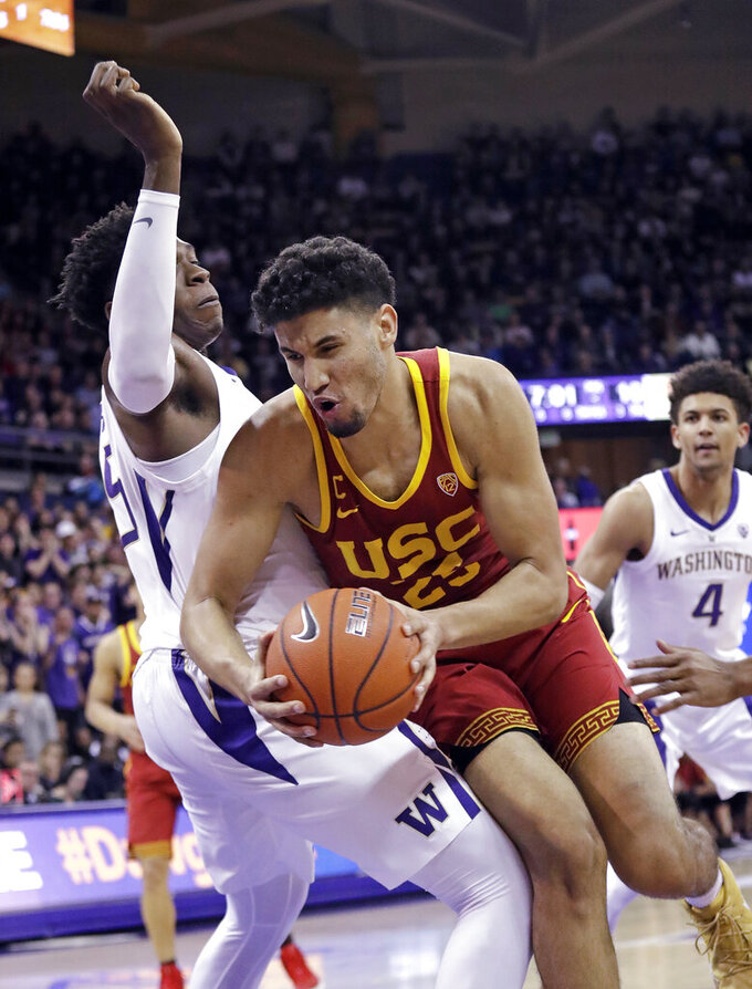 Southern California's Bennie Boatwright, right, tries to muscle past Washington's Noah Dickerson during the first half of an NCAA college basketball game Wednesday, Jan. 30, 2019, in Seattle. (AP Photo/Elaine Thompson)