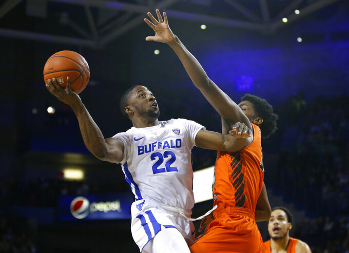 Buffalo guard Dontay Caruthers (22) goes up against Bowling Green guard Justin Yurner (10) during the first half of an NCAA college basketball game, Friday, March 8, 2019, in Buffalo, N.Y. (AP Photo/Jeffrey T. Barnes)