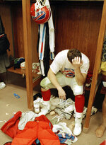 FILE - In this Jan. 27, 1991, file photo, Buffalo Bills' Mark Pike sits in the locker room afterhis team lost Super Bowl XXV to the New York Giants in Tampa, Fla. The Bills lost four straight Super Bowls in the early 1990s and had the longest active postseason drought of any North American franchise (2000-16) before making the playoffs this season. (AP Photo/Lennox McLendon, File)
